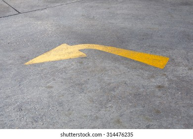 yellow arrow on the floor, turn left