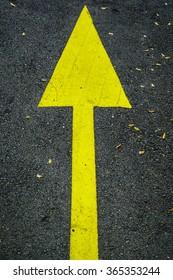 yellow arrow on road