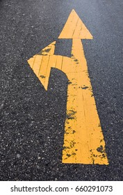 Yellow arrow on a road