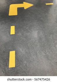 Yellow arrow sign turn right on the road