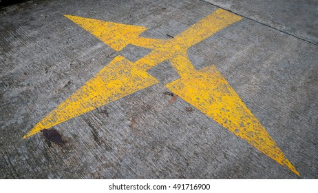 Yellow Arrow signs on the road.