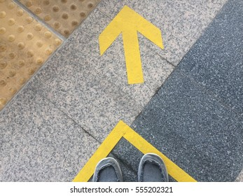 yellow arrow symbol on floor.