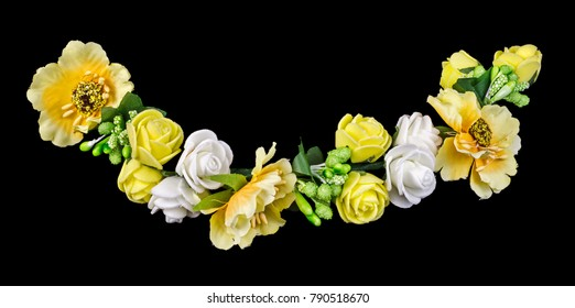 Yellow artificial flowers isolated on black background. Clipping path included.
