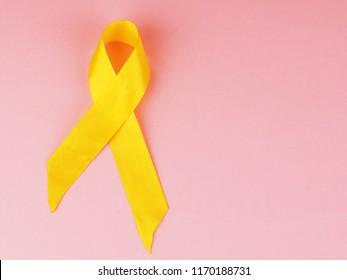 Yellow awareness ribbon on light background.