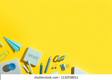 Yellow background and blue school supplies. Back to school. Flat lay.