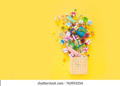 Yellow background. A box with accessories for a birthday, a party or a new year.