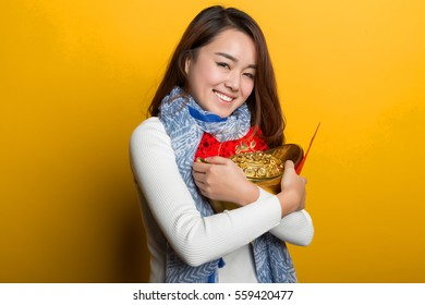 Yellow background, Chinese girl holding gold and blessing bag, Asian custom figure series