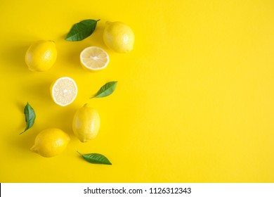 Yellow background. Lemon fruit. Flat lay, top view, copy space