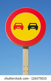 Yellow background No overtaking signal in a road