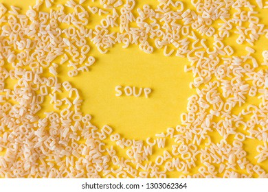 yellow background with pasta. the word soup of letters. alphabet.