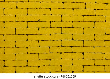 Yellow background, background picture, brick wall, for advertisement insert text A yellow wall. The yellow brick. Large brick wall