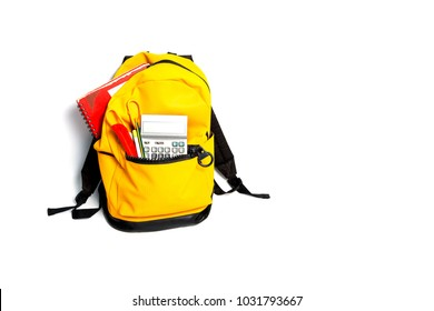 Yellow Backpack with school supplies, isolated on white background.