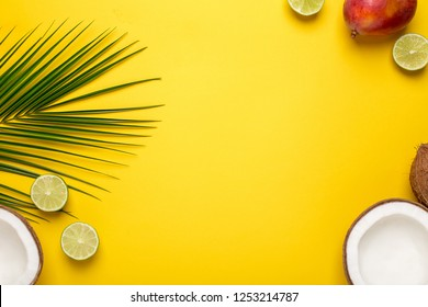 Yellow backround with tropical coconut, palm tree and fruits top view