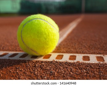 Yellow ball on the court ground
