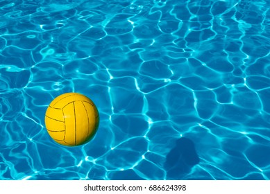 Yellow ball in the pool. Summer background for design. Sunny day at the resort