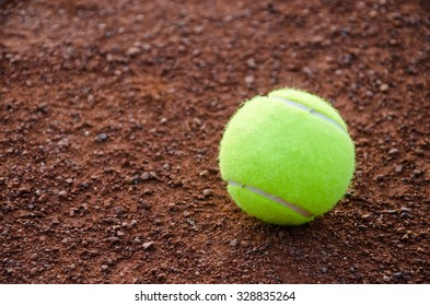 Yellow ball for tennis on ground court cover. Selective focus. For background, backdrop, catalog print, web use with space for a text.