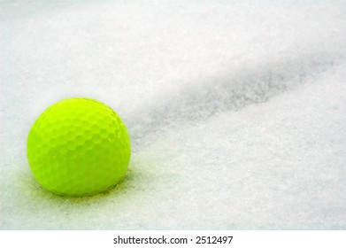yellow ball for winter golf on to snow