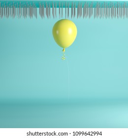 Yellow Balloon floating on top nail trap celling on blue pastel background color. minimal idea concept.