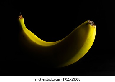 Yellow banana on black background