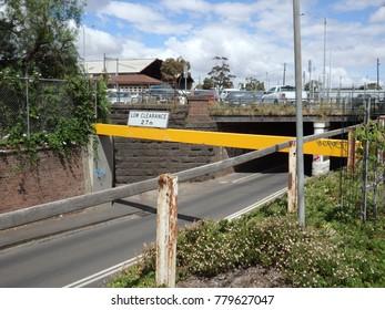 Yellow bar before bridge on a dirt road inner city