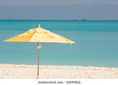 yellow beach sunshade umbrella on a tropical beach