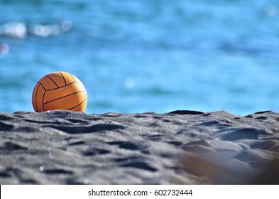 yellow beach volley ball on sand