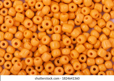 Yellow Beads on the white background. Background or texture of beads. Close up, macro,It is used in finishing fashion clothes. make bead necklace or string of beads for woman of fashion.