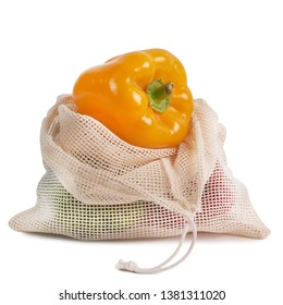 Yellow bell pepper california in perforated cotton storage bag eco friendly isolated on white background