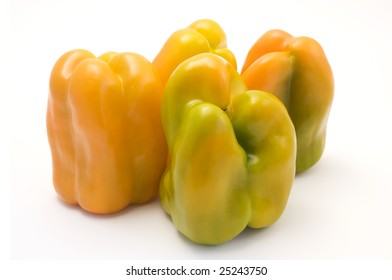 Yellow bell peppers (Capsicum annuum) on a white background