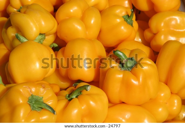 yellow bell peppers with green steams fresh from the fields