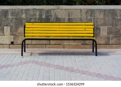 Yellow bench on sunny day
