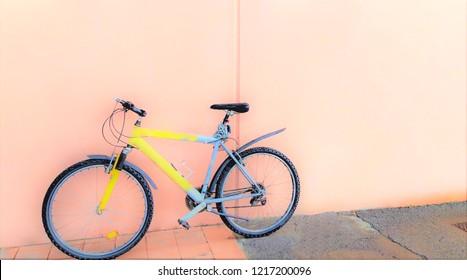 yellow bike near the wall