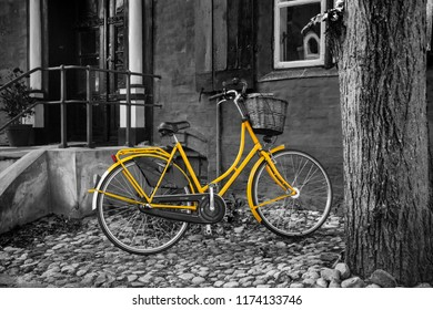 Yellow bike on black/white back