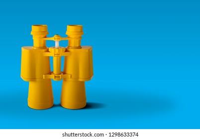 Yellow binoculars isolated on blue background