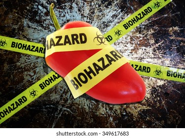 Yellow biohazard tape across a pepper -- food safety concept