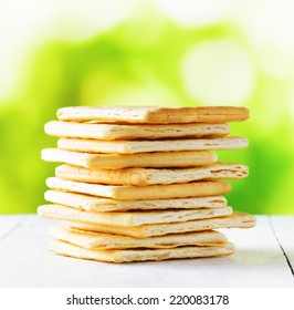 Yellow biscuit on nature background. Close up view.