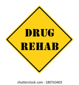 A yellow and black diamond shaped road sign with the words DRUG REHAB making a great concept.