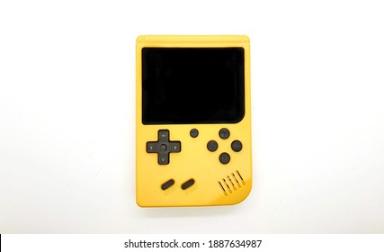 Yellow with black game console portable gaming device. isolated on a white background