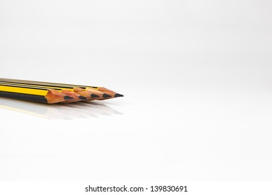 yellow and black grated pencils