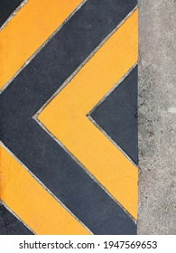 Yellow and black lines (looking like arrows) or yellow lines on the curb or footpath are