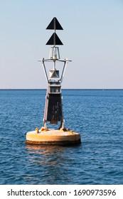 Yellow black North Cardinal buoy is on water of Persian Gulf, Saudi Arabia