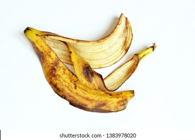 Yellow and black ripe banana skin. Banana peel on a white background. View from above.