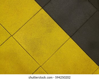 yellow and black rubber floor tiles