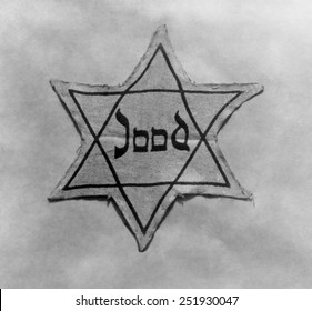 Yellow and black star which the Jews were required to wear in occupied Holland during World War 2.
