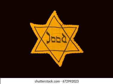 Yellow and black star which the Jews were required to wear in occupied Holland during World War 2, dutch language
