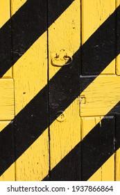 yellow and black striped wooden door