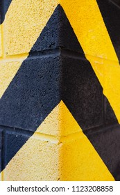Yellow and black stripes on the wall