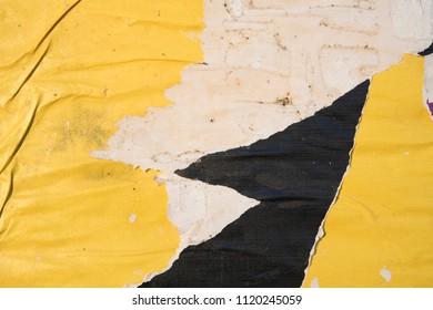 yellow black torn street poster