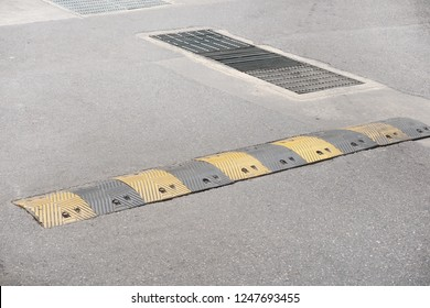 yellow and black washboard road on road .