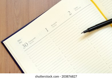 Yellow blank notepad on office wooden table